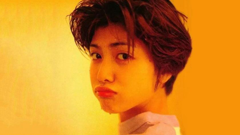 尤其94年她拍了一本短发泳装写真《yukiss》,打破了无数人心中长发